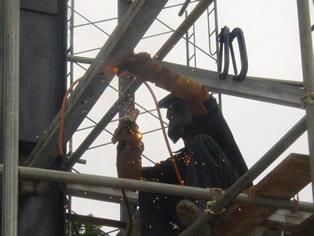 Man welding on Oil Rig